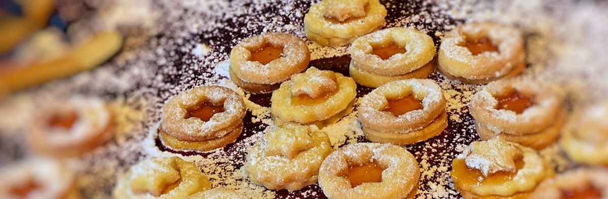 Photo of shortbread cookies with jam filling.